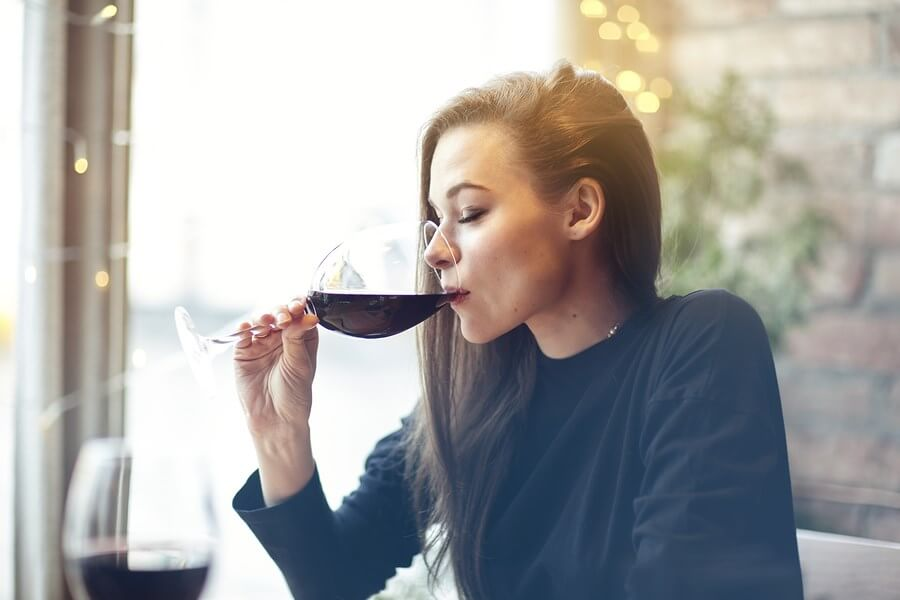 A beautiful young women sensuously drinking one of the top wines, enjoying herself!