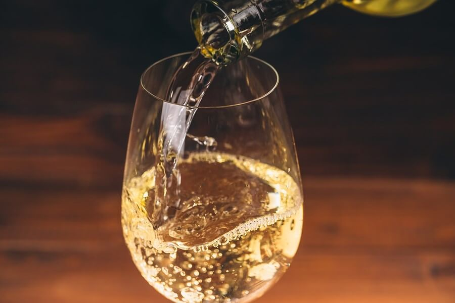 Wine being poured slowly into a glass, the bottle once opened will turn into wine vinegar
