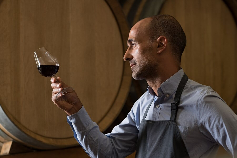 One of the best winemakers inspecting a wineglass, testing the fruits of his labor!