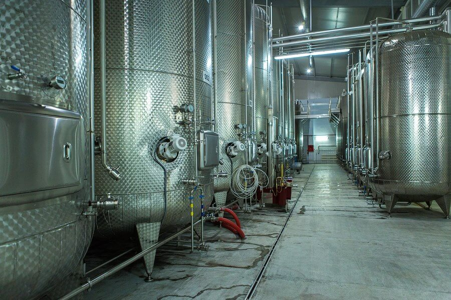 Wine fermenting in stainless steel vats, displaying amazing wine making technology!