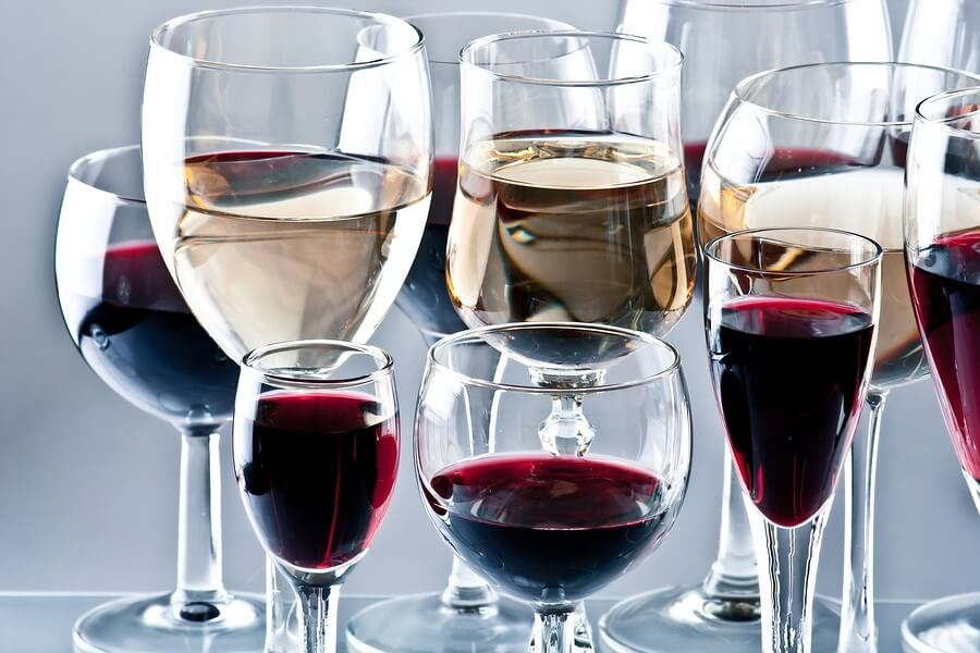A beautiful display of wine glasses filled with different wines, just begging to be drunk!