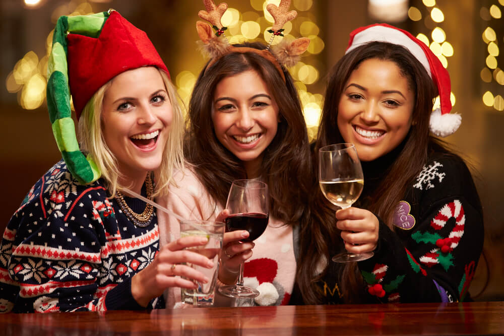 Christmas Wine - Beautiful scene of friends enjoying Christmas with wine and other beverages!