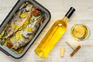 Beautiful cooked fish along white wine varieties