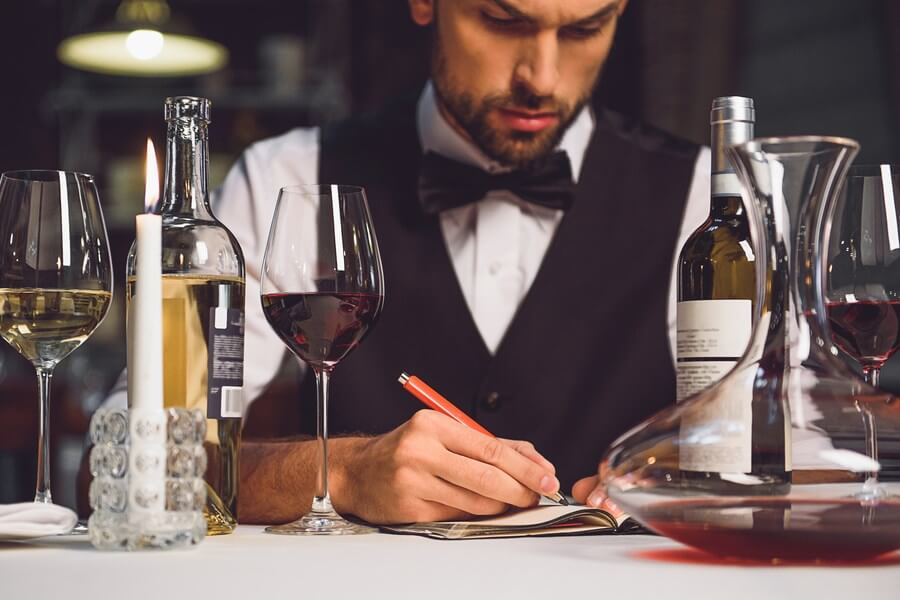 A wine critic, tasting delicious wines and scoring them. Wine critics are crucial to the industry!