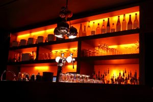 Best Montreal Wine Bars! A picture of a dark, romantic Montreal Bar!