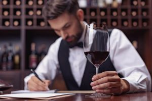 Sommelier Training - A Sommelier scores wine he has just tasted!
