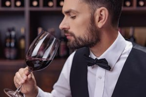 Wine Palate - A Sommelier smelling a beautiful vintage of red wine, ready to describe it's wonderful features!