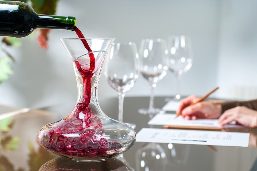 A beautiful red wine being poured into an amazing wine decanter, a great idea for a wine-related gifts