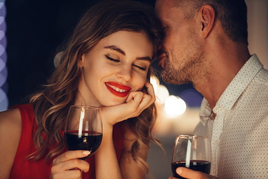 Beautiful Wine Drinkers on an intimate date enjoying the beautiful atmosphere and wine!