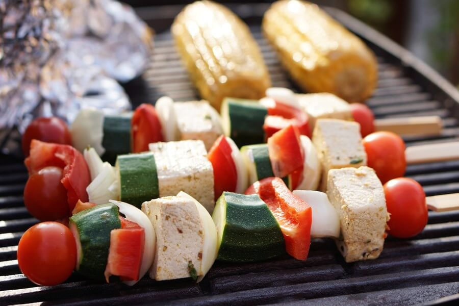 Tofu Wine Pairing: Tofu Kebabs on the grill with juicy tomato, peppers, and zucchini! Corn in the background!